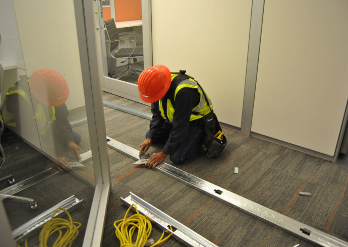 construction worker cutting metal studs
