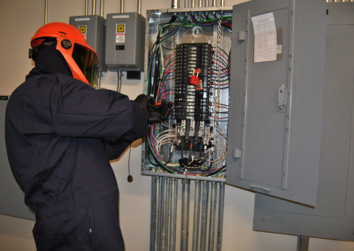 installing the electrical box and hooking up breakers